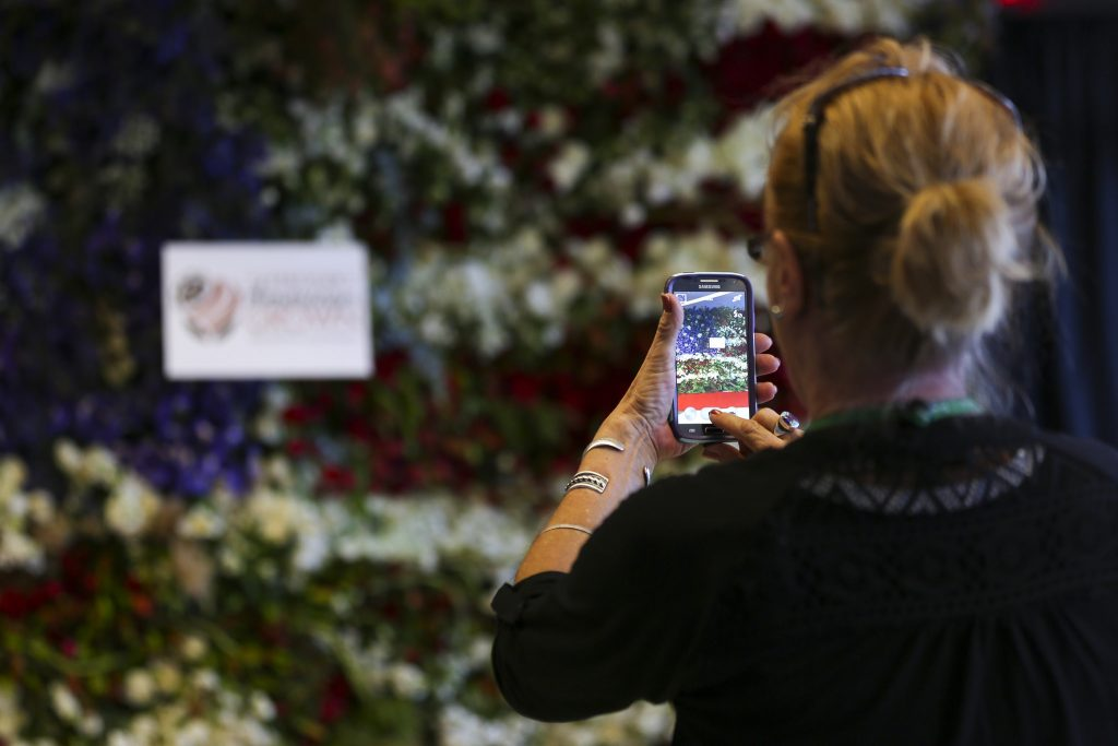 Photographing the American floral flag was a popular activity at this international conference.